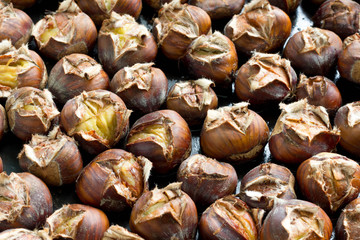 Baked chestnuts on baking pan.