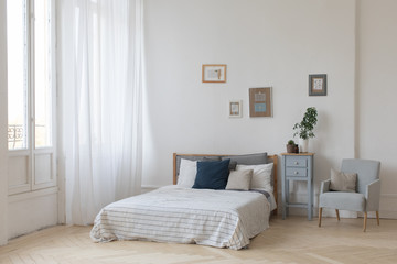 Interior of white and gray cozy bedroom