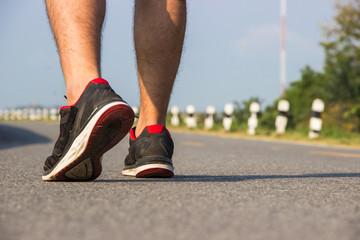 Young man are exercising Weight Control,Closeup leg
