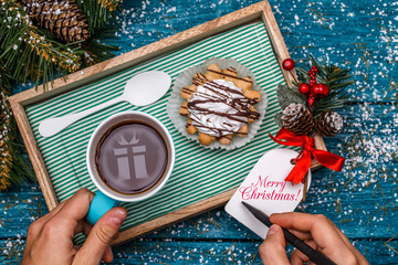 New Year's photo of tea with picture of gift, cake