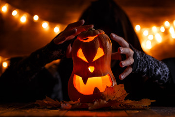 Image of halloween pumpkin cut in shape of face with witch