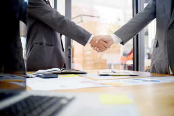 businessman shaking hands finishing up a meeting,acquisition concept.