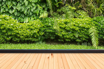 Wood flooring in a green plant garden decorative