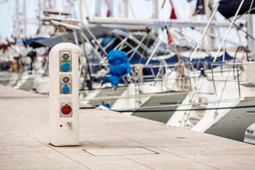 electrical outlets for charging on boats in the harbor background