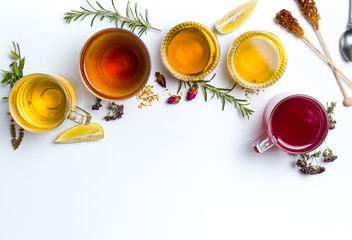 Herbal tea collection glasses on white background