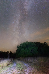 rural ground road and a milky way night scene