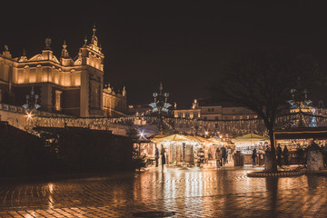 KRAKOW, POLAND - DECEMBER 22, 2016: Annual Christmas market at the Main square (Rynek Glowny). The market starts in the last week of November and lasts through December 26th.