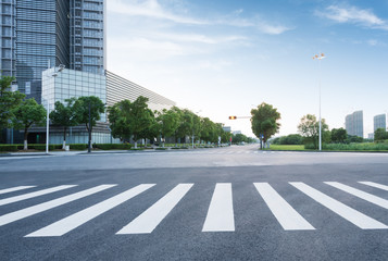 Fotomurales - empty road with modern buildings on background,shanghai,china.