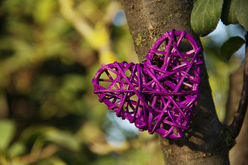 Wicker heart on a natural background. Copy space
