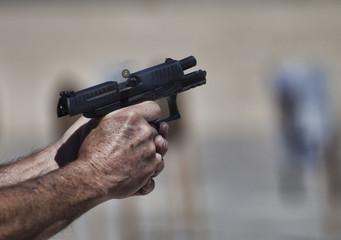 Handgun under recoil
