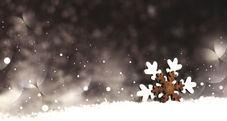 Snowflake in the snow on a dark background