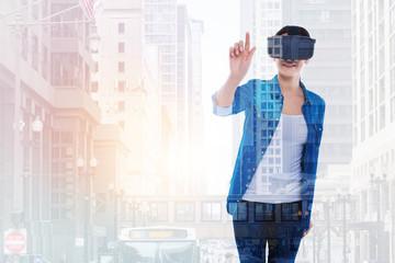 Charming woman enjoying virtual reality games
