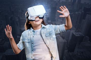 Cute girl in white VR headset scrutinizing sky