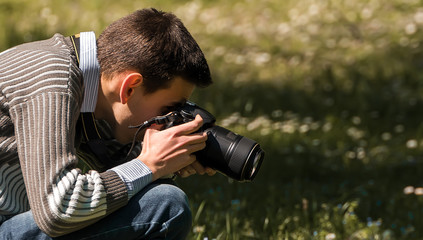 Nature photographer on grass