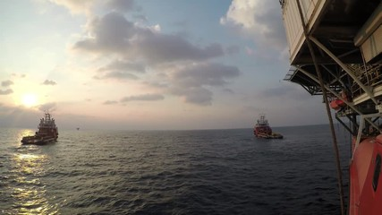 Wall Mural - Supply boat for oil drilling rig in the middle of the ocean