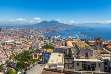 Fotobehang Napels Panorama of historic Naples and volcano Vesuvius from the Castle Sant'Elmo on the Vomero hill, Naples, Italy