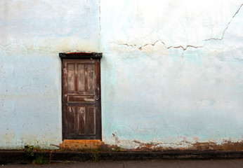 old vintage door with old vintage blue crack wall