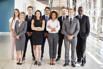 Office workers in a modern lobby, full length group portrait Wall mural