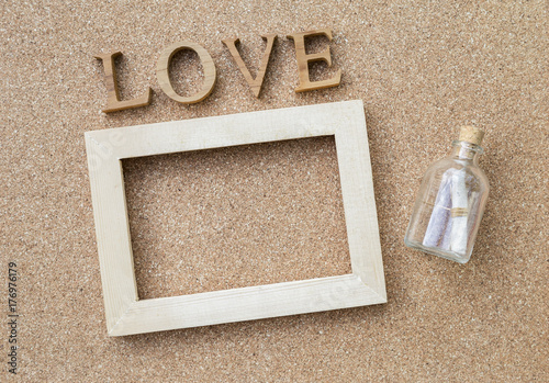 Love Message Message Bottle And Wooden Frame With Love Text On