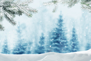 Fotobehang Lichtblauw Merry christmas and happy new year greeting background with copy-space.Winter landscape with snow and christmas trees