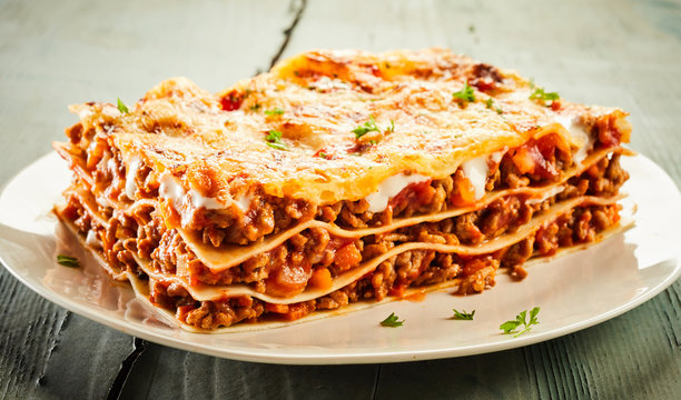 Slice of delicious beef lasagne on a plate