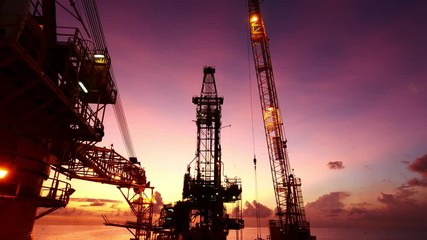 Wall Mural - Derrick of Tender Assisted Drilling Oil Rig (Barge Oil Rig) on The Production Platform During Sunrise