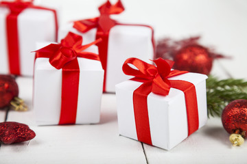 Gifts with red bows and Christmas decorations