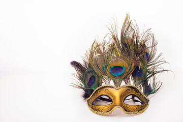 Venetian carnival mask with peacock feathers