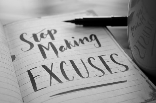 STOP MAKING EXCUSES hand-lettered in notebook