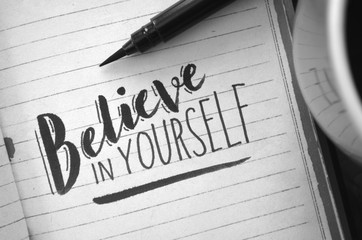 BELIEVE IN YOURSELF hand-lettered in notebook
