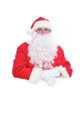 Kind Santa Claus holding copy space area, isolated on white background