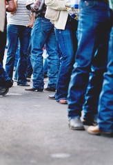 Group of people in jeans and cowboy boots