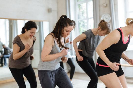 Aerobics Class Exercising In Bright Studio
