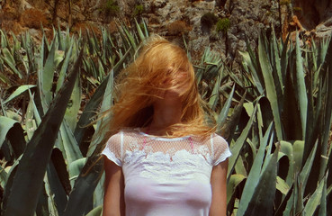 redhead woman in cactuses