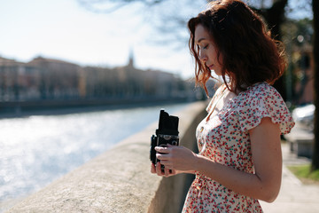 Beautiful woman holding a vintage camera