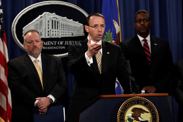Deputy Attorney General Rosenstein addresses news conference at Justice Department in Washington
