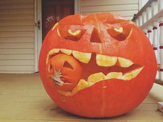 A pumpkin eating another pumpkin