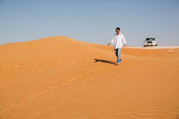 Man walking alone in the desert