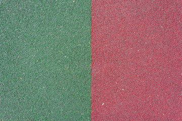 textured surface in red and green