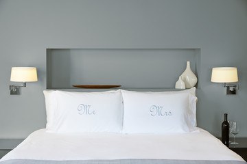 Mr & Mrs Pillowcases on bed in bedroom