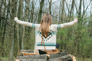 Anonymous female model in skvo sweater in forest
