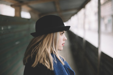 real young woman with black hat