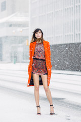 Bright orange jacket in the falling snow