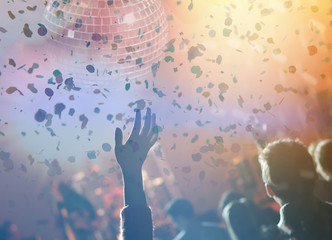 Disco ball with lights and confetti. Party background