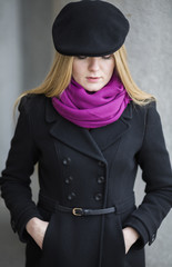 Young woman with black hat .