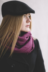young woman with  black hat on the street .