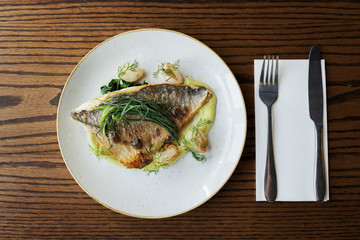 Sea bream with monk's beard, turnips and spinach