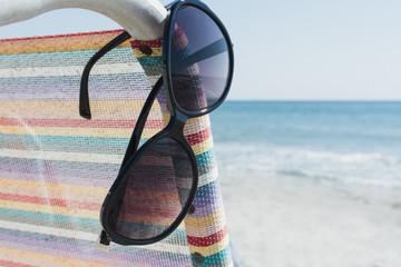 Sunglasses on beach chair. Florida.