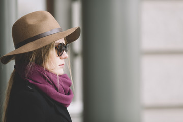 young woman with hat and sunglasses on the street