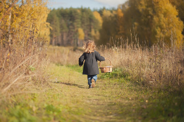 little girl runing to the forest for the mushrooms
